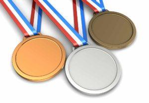 Golden, silver, bronze champion medals isolated on a white background
